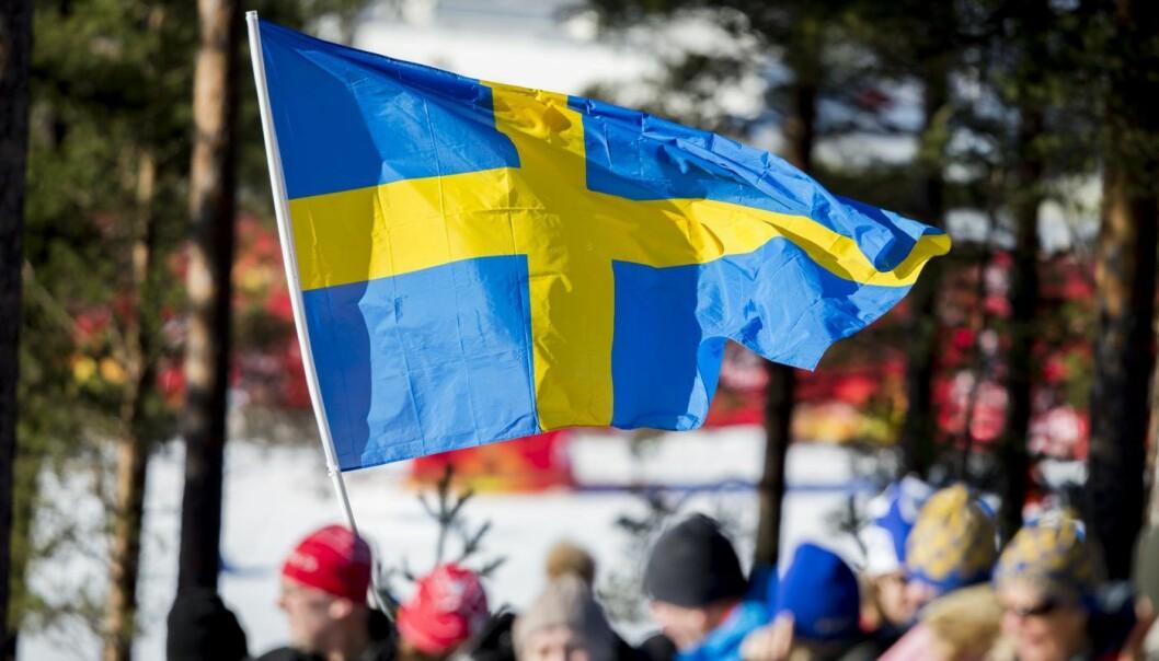 Et svensk flagg på Lugnet skistadion i Falun. Foto: Vegard Wivestad Grøtt / NTB scanpix