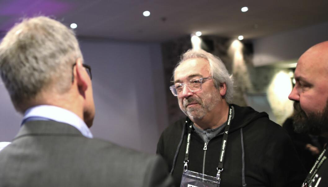 Erling Maartmann-Moe, partner i Alliance Venture, snakker med investorer på en investorfrokost like før Slush-arrangementet åpner. Selskapet har nylig investert i APEXX, en innovatør innen pengeoverføringstjenester. Foto: Lucas Weldeghebriel