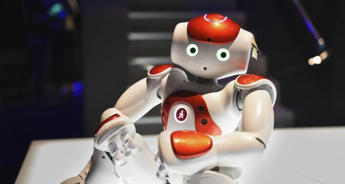 Robotselskapet Tieto stod på stand, og viste frem to roboter -- den ene med røde fargeinnslag, og den andre med blå. Foto: Benedicte Tandsæther-Andersen