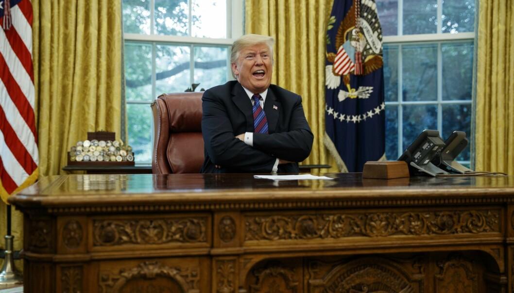President Donald Trump, for anledningen på høyttalertelefon med den meksikanske presidenten. Foto: AP Photo/Evan Vucci