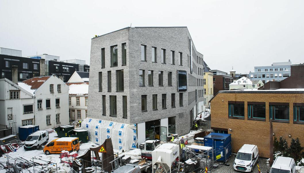 Et stort nybygg på Peter Egges plass blir koblet sammen med flere trebyggninger i Søndre gate, og med det får Trondheim 5.100 m2 hvor byens gründere, investorer og innovasjonsinteresserte kan boltre seg. Foto: Martine Leins Skrove