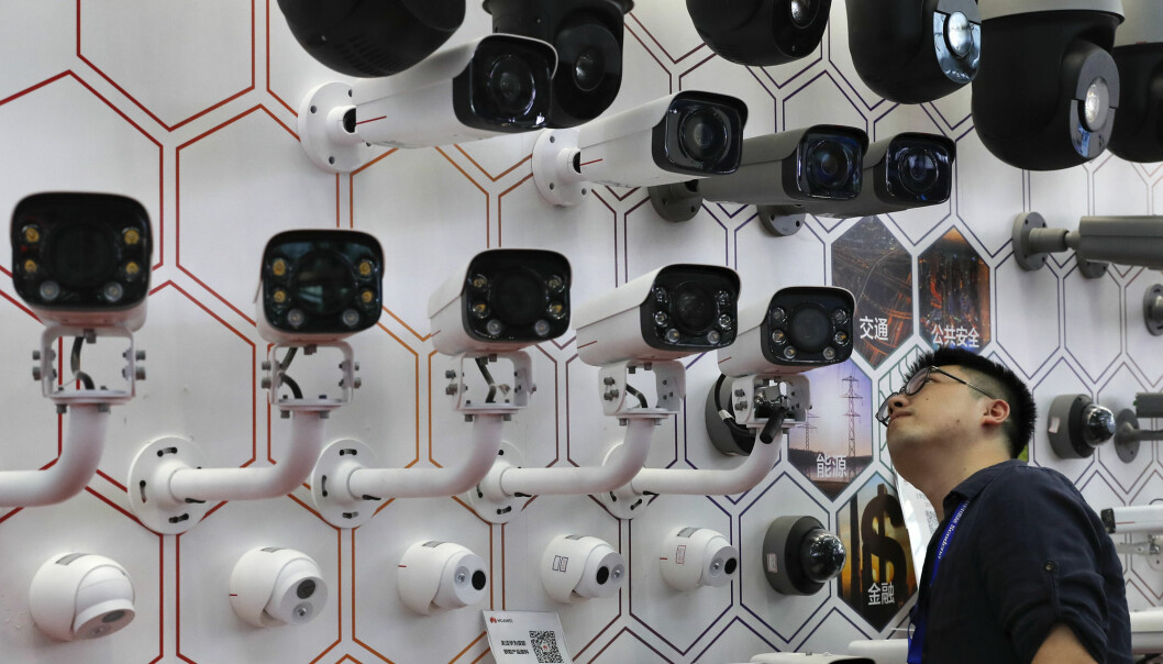 A man takes a closer look at the surveillance cameras by China's telecoms equipment giant Huawei on display at the China Public Security Expo in Shenzhen, China's Guangdong province