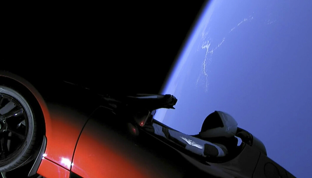 This image from video provided by SpaceX shows the company's spacesuit in Elon Musk's red Tesla sports car. (SpaceX via AP)