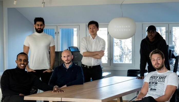 Teamet: Fra venstre sittende Shafi Adan, Jan Oftedahl og Arne Kvale. Fra venstre bak, stående: Anders Gill, Jørn Skogsrud og Abdirahim Arrale .