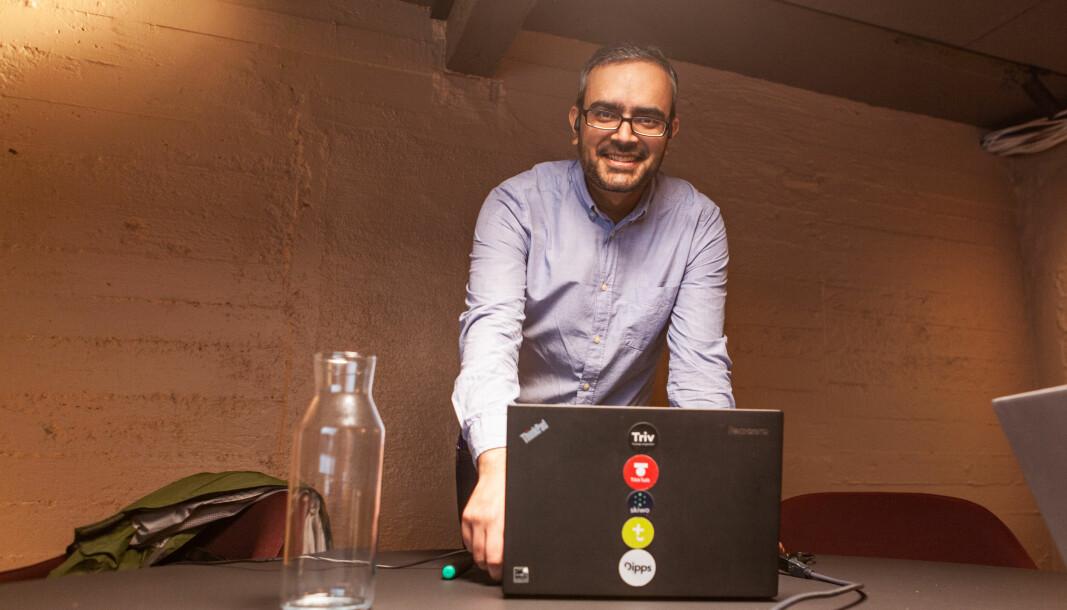 Skiwo-sjef Gautam Chandna har fylt laptopen sin med logoer til alle selskapene i Skiwo-gruppen